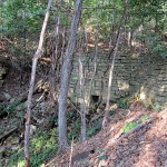 Culvert in Retaining Wall, under abandoned roadway, east side of Great River Rd., (X56), 1.1 mile north of Pikes Peak Rd., Mendon Township